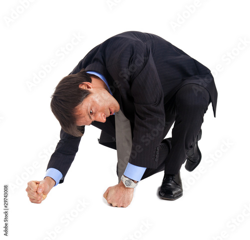 Businessman punching the ground isolated on white