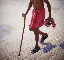 Beggar a walking cane in Varanasi, India