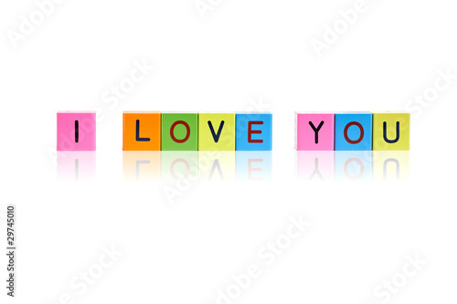"phrase ""I love you"" formed from wooden letter blocks"