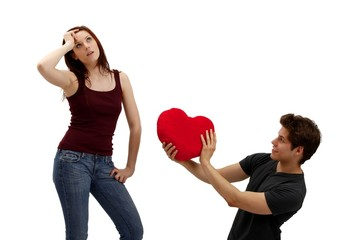 young couple with a heart (white background)
