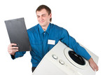 Repairman servicing washing machine