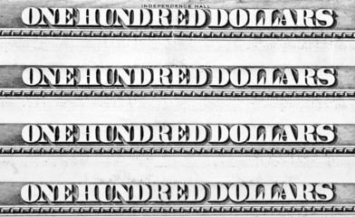 Row of one hundred dollars banknotes