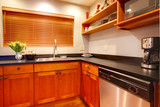 Modern cherry luxury kitchen with black ans stain steal. poster