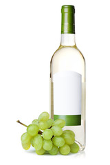 White wine in bottle with blank label and grapes