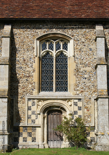 Door and window of St Mary's church in Cavendish, Suffolk.