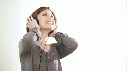 Woman dancing while listening to music; HD 720, H 264