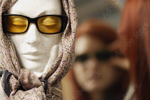 Mannequin Head Modeling Sunglasses And Scarf