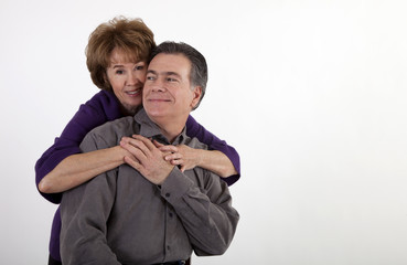 Playful Middle-Aged Couple Smiling