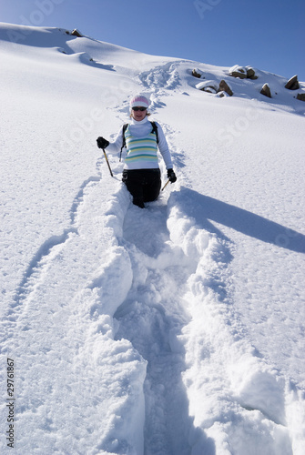 Woman on a snow path in the mountains