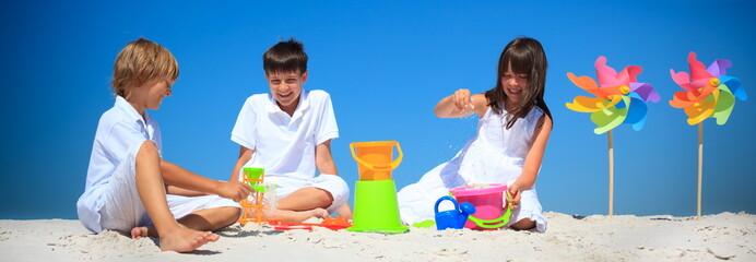 Children playing in beach sand