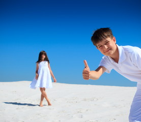 Children on white sand beach