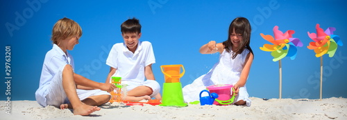 Children playing in beach sand