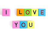Phrase I LOVE YOU formed from wooden letter blocks poster