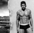 Sexy  portrait of a very muscular male model with view of Rome