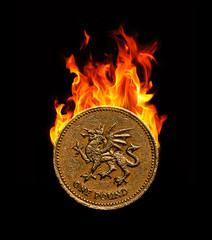 Pound coin on fire