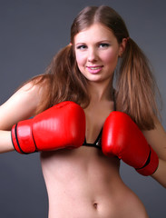Woman boxing punching red gloves