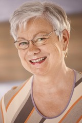 Portrait of happy senior woman with glasses