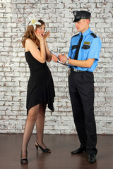 The policeman writes the report.  Interrogation of the witness