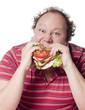 homme boulimique dévorant un sandwich