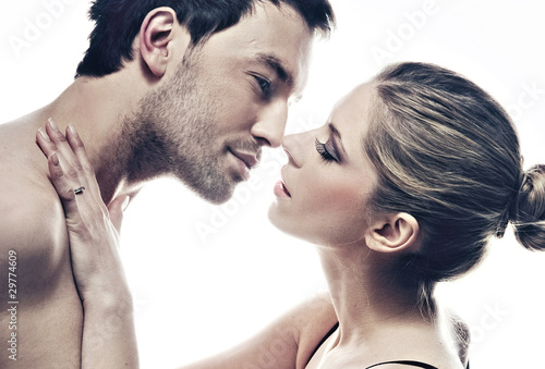 portrait of handsome couple gently kissing