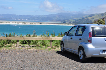rear side view of car parked near to beach
