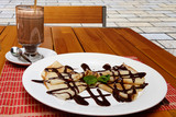 Delicious pancakes with chocolate drink