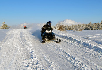 mans goes on a snowmobile
