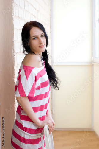 Caucasian young woman in light room