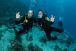 scuba divers having fun