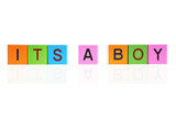 phrase ITS A BOY formed with wooden letter blocks poster
