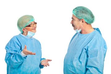 Middle aged surgeons having conversation