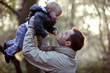 A father lifting his son in the air