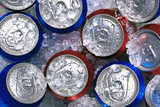Cans of drink on crushed ice
