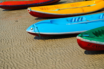 colorful boat on the beach.