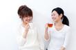two beautiful asian women talking