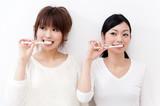 Fototapety two beautiful asian women blushing her teeth