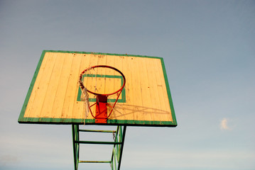 Basketball board with an old tattered basketball net on the hoop