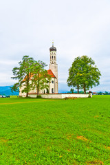 typical bavarian or austrian landscape with a chapel