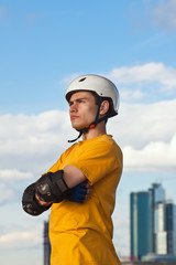 young man in helmet and protective gear
