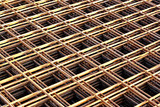 Stacked rebar grids at the construction site poster