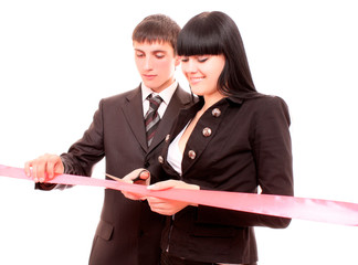 Man and woman cutting red ribbon isolated on white