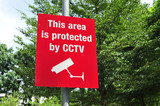 Red Sign Warning Of CCTV In Operation poster