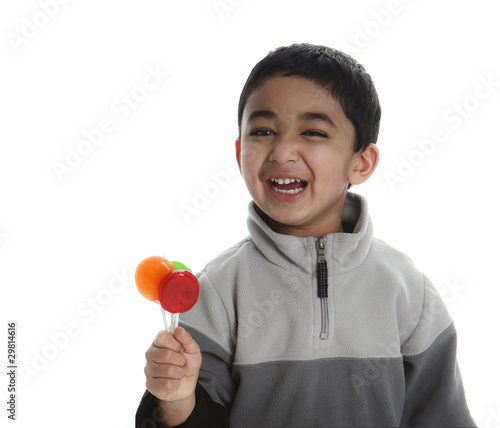 Happy Child with Three Colorful Lollipops, isolated, white