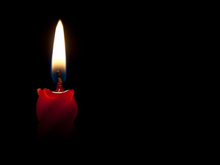 Burning red candle