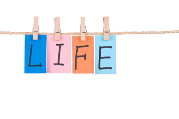 Life, Colorful words hang on rope