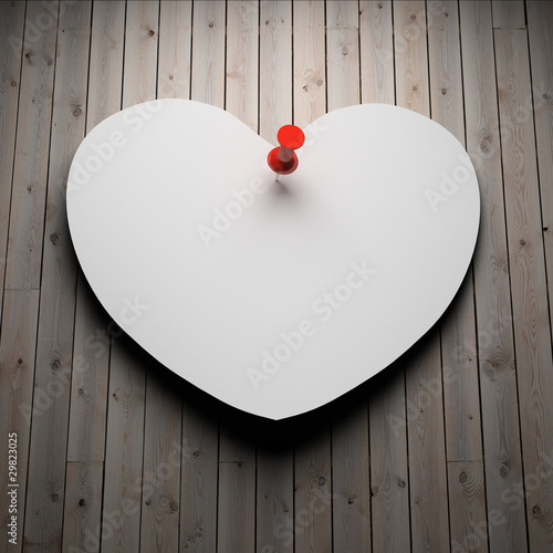 Blank paper heart on wood