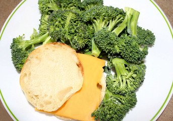 English muffin with cheese and broccoli