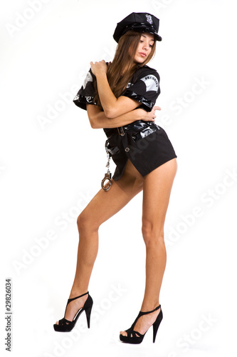 very sexy police women with cuffs isolated on white