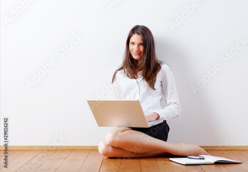 Young business woman at home with notebook