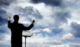Music conductor and clouds